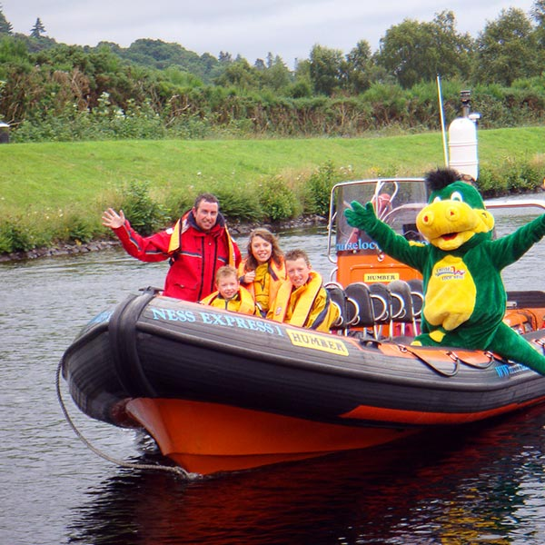 Ron, family, and Nessie on a new rib boat